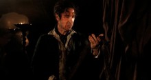 eighth_doctor_holds_bandolier